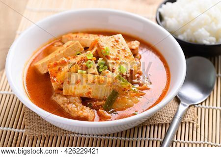 Kimchi Soup With Tofu And Pork In A Bowl Eating With Cooked Rice, Korean Food