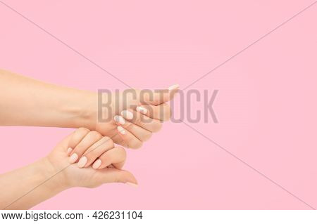 Close-up Women's Hands With Beautiful Manicure Isolate On Pink Background. Top View. Stylish Trendy