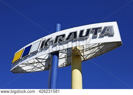 Umea, Norrland Sweden - June 12, 2021: Large Tall Sign With The Name Of A Finnish Company