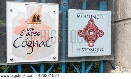 Cognac , Aquitaine France  - 06 30 2021 : Monument Historique And Les Etapes Du Cognac Logo Brand An