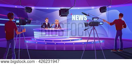 Tv Presenters Broadcasting News In Modern Television Studio With Cameraman, Light Equipment And Eart