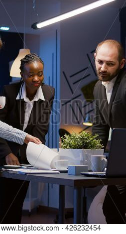 Business Diverse Teamwork Solving Management Strategy Analyzing Company Graphs Using Computer While