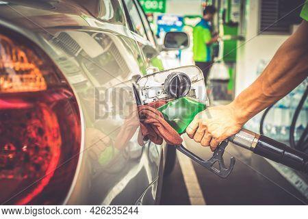 Car Refueling In Tank Car On Petrol Station. Man Pumping Gasoline Oil.