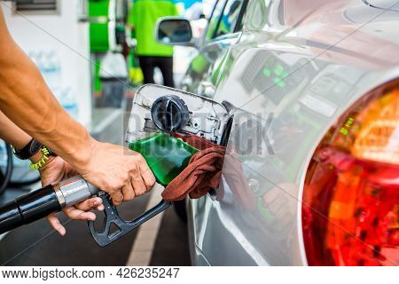 Car Refueling In Tank On Petrol Station. Man Pumping Gasoline Oil. This Photo Can Be Used For Fuel I