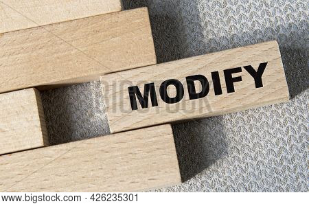 Modify - Word On A Wooden Bar On A Gray Background. Business Concept