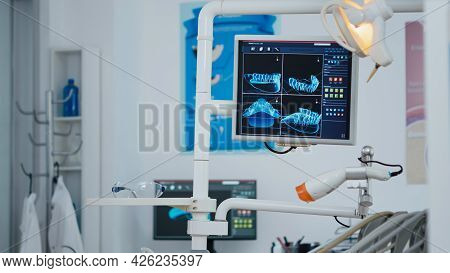 Close Up Revealing Shot Of Medical Stomatology Display With X Ray Images On It. Empty Professional H