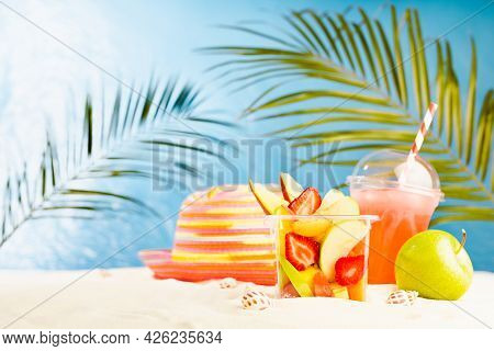 Resort Lifestyle - Picnic With Cold Cocktail, Fresh Tropical Fruit Salad, Sun Hat On White Sand With
