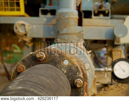 Pipe Connection For Concrete Mixer Machine Presenting At Industrial Background.
