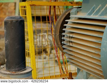 Electric Supply Motor Side Look Around Industrial Background.