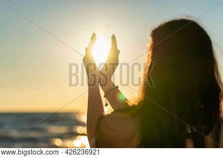 Nice Summer Sun Solstice Concept. Silhouette Of Young Woman's Hands Relaxing, Happy Meditating And H