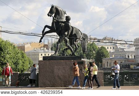 Saint - Petersburg - July 11, 2021: One Of The Horse Tamers Statues At Anchovy Bridge By Peter Clodt