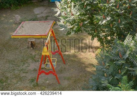 Swing And Sandbox For Children On Playground. View From Above.