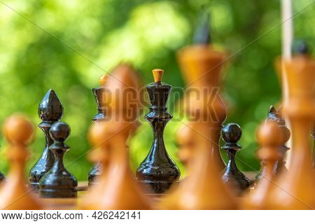 Chess Pieces Of Shabby Old Chess Pieces On A Chessboard Close Up - Black King In Selective Focus