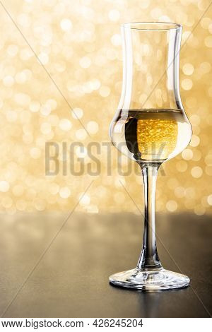 Italian Golden Grappa Drink On Brilliant Golden Background