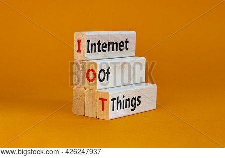 Iot, Internet Of Things Symbol. Wooden Blocks With Words Iot, Internet Of Things On Beautiful Orange