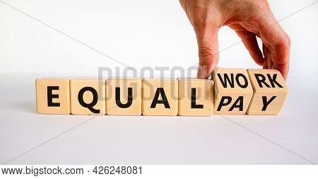 Equal Pay And Work Symbol. Businessman Turns Wooden Cubes And Changes Words Equal Pay To Equal Work.