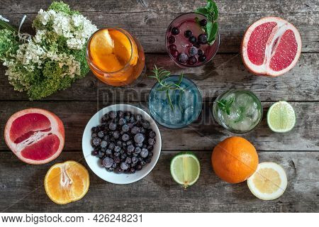 Cocktail Gin Tonic, Mojito And Aperol Spritz With Mint, Ice, Lime, Berries, Grapefruit And Orange On