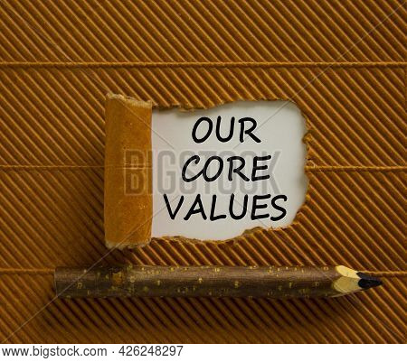 Our Core Values Symbol. Words 'our Core Values' Appearing Behind Torn Brown Paper. Wooden Pencil. Be