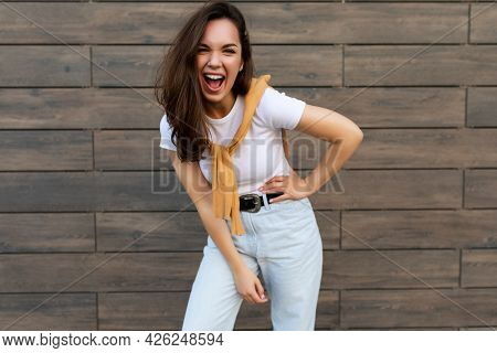 Photo Of Emotional Positive Happy Joyful Pretty Young Brunette Woman In Trendy Outfit. Beautiful Att