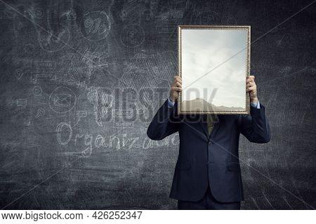 Man holding blank poster . Mixed media