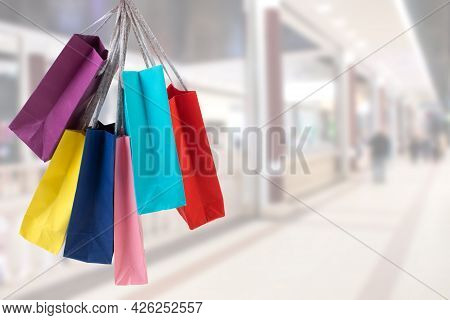 Many Colorful Shopping Bags On The Background Of The Shopping Center. Black Friday