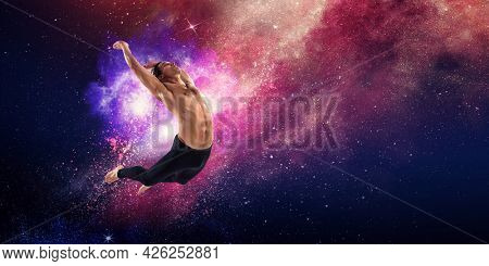 Male dancer against abstract colourful background