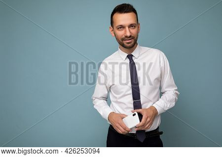 Photo Of Handsome Good Looking Brunet Unshaven Man With Beard Wearing Casual White Shirt And Tie Iso
