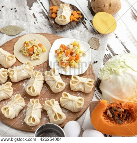 Cooking Process. Dumplings Stuffed With Pumpkin, Potato And Cabbage. Convenience Food. Slices Of Raw