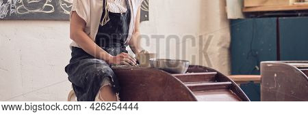 Banner Female Potter Creating A Earthen Jar On A Potters Wheel
