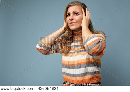 Photo Of Young Dissatisfied Attractive Blonde Curly Woman With Sincere Emotions Wearing Casual Strip