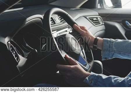 Young Man Steering Car Side View Close Up. Man Hold Steering Wheel In Casual Cloth