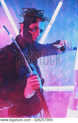 A brave sci-fi cyborg samurai man in a protective suit fights with sword and a gun in his hands in neon light. Cyberpunk world. Game, virtual reality.