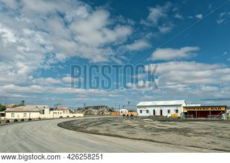 Prince Albert Road, South Africa - April 20, 2021: A Street Scene, With A Railway Station And Farm S