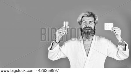 Sick Man On Red Background. Copy Space. Diseased Man On Quarantine. Drink Water Glass. Flu And Cold.
