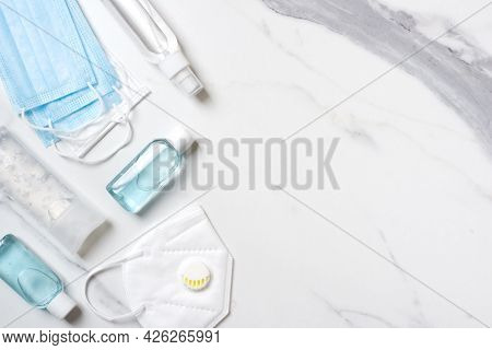 Virus Protection Concept Background With Facemasks And Hand Sanitizer Bottles