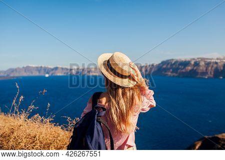 Traveler Woman Walking On Santorini Island, Greece Enjoying Landscape. Happy Hiker Enjoys Caldera Vi