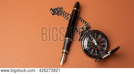 Fountain Pen And Clock, Beautiful Details Of A Fountain Pen And An Antique Clock Exposed On A Leathe