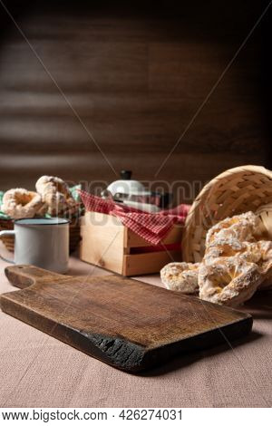 Brazilian Sweet Biscuit And A Cup Of Coffee On A Table With Beige Tablecloth, Selective Focus.