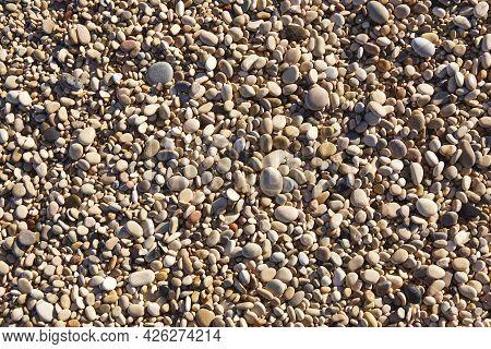 Mediterranean Shoreline Peeble Beach. Natural Textured Background. Nobody