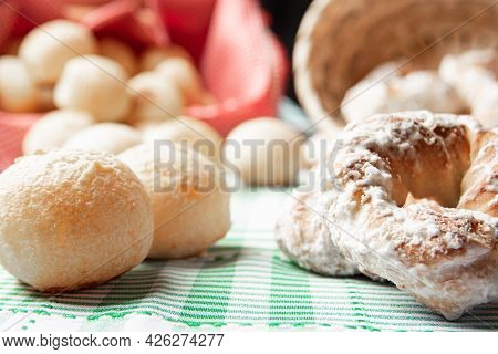 Brazil Cheese Bread And Sweet Biscuit On A Table With Green Checkered Tablecloth, Selective Focus.