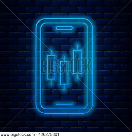 Glowing Neon Line Mobile Stock Trading Concept Icon Isolated On Brick Wall Background. Online Tradin