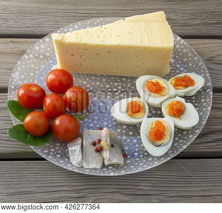 Stockholm, Sweden - April 7, 2021: A Glass Plate With Typical Swedish Food With Cheese, Eggs, Herrin