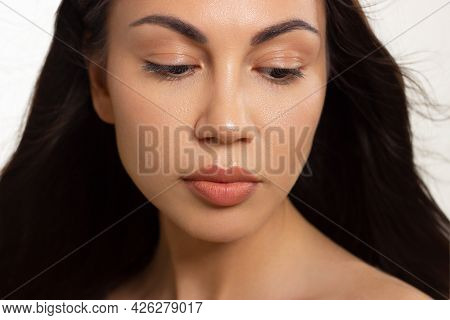 Close-up Portrait Of A Beauty Woman With Full Lips, Straight Hair And Perfectly Clean Skin. Daytime