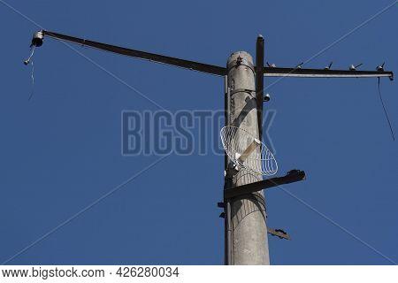 Concrete Pole With Eleptic Radio Transmitting Antenna.