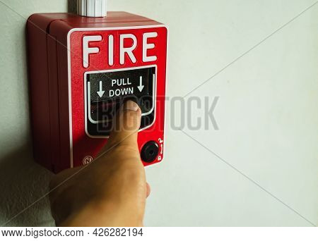 Buttons Of Alarm Devices In Buildings Or Offices. Hand Presses The Fire Alarm Button. When An Emerge