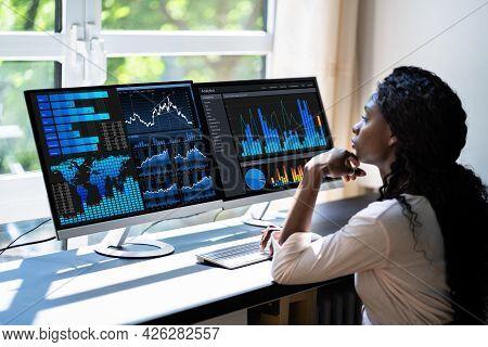 African Advisor Using Kpi Dashboard With Financial Analytics Graphs