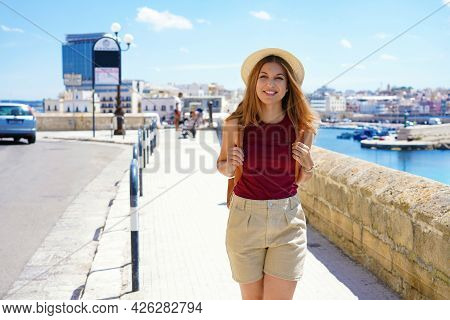 Summer Tourism In Italy. Young Woman Strolling In Gallipoli Seaside Town Of Apulia.
