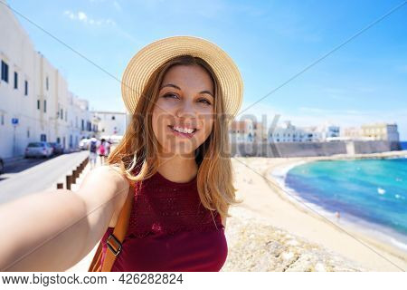 Happy Young Woman Taking Self Picture By Smartphone Capturing Moments On Summer Vacations Trip