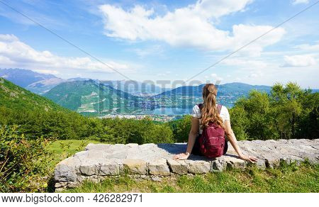 Female Hiker Relaxing After Trekking On Mountains Enjoying View From Belvedere