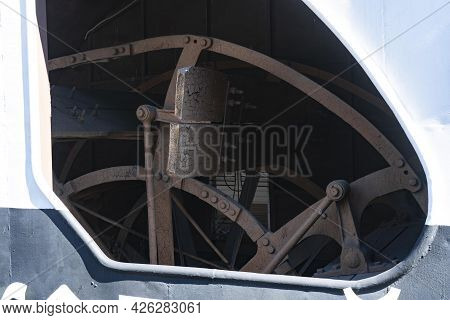 The Rowing Wheel Of An Old Steamer.